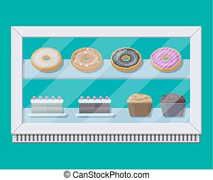 Bakery shop vitrine freezer with cakes and pastry. Donut,...