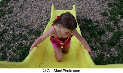 View of girl on the slide at playground
