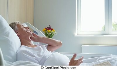 Aged male in patient talking on phone in a hospital - Good...