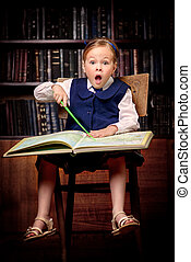 study the geographical atlas - Funny excited girl sitting...