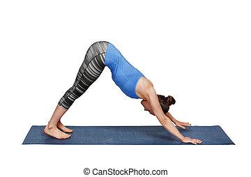 Woman doing Ashtanga Vinyasa yoga asana Adhomukha svanasana...