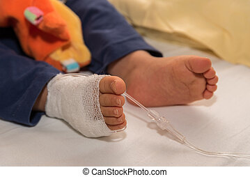Child gets infusion - close-up cannula - Infants are infused...