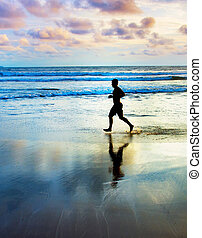 Jogging at the beach - Man running on the tropical ocean...