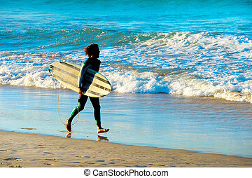 Surfer running with surfboard - Man running with surfboard...