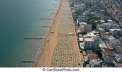 Aerial view of a huge crowded sandy beach in Italy. Summer...