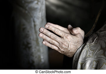 Hands of aged person in prayer