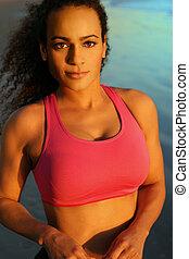 Fitness female model against ocean