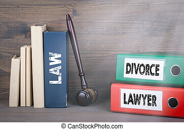Divorce and Lawyer concept. Wooden gavel and books in background