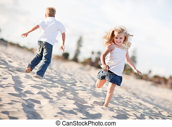 Adorable Brother and Sister Having Fun at the Beach One...