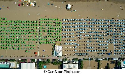 Aerial top down view of a big crowded sandy beach in Italy....