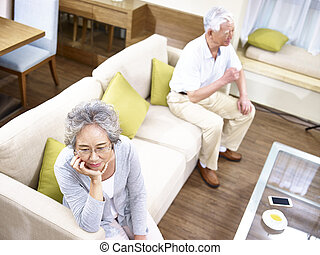 senior asian couple having relationship problem angry with...