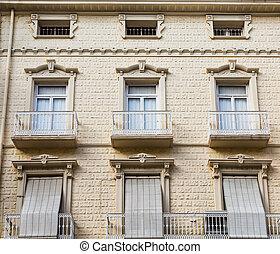 Six Windows in Beige Stone Building