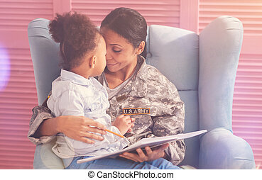 Adorable daughter and mother doing an Eskimo kiss - Motherly...