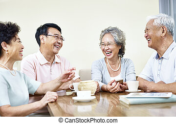 senior asian people having a good time - small group of...
