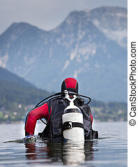 Diver walking in shallow water - Diver with full equipment...