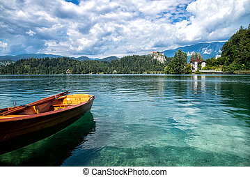Lake Bled, Slovenia, Europe. Mountains with valley and boat...