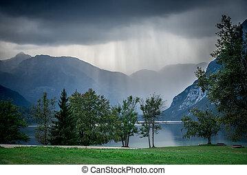Lake bohinj, Slovenia, Europe. Mountains at the rain on...