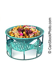 Potpourri in flowerpot on a white background