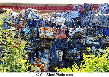 scrap metal scrap-iron junk outdoor stacked rows