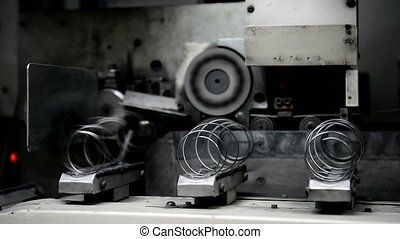 Process of production springs from wire on the plant is...