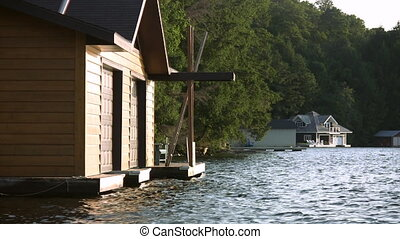 Sunny boathouse. - View of sunlit boathouse with another...