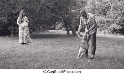 Dad holding his baby and whirling with her - Dad holding his...