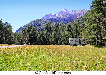 Camper autocaravan meadow in Pyrenees mountain sunny day...