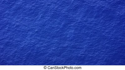 Sea water texture background. Calm sea with small waves and ripple. Sea top view. Blue water background texture. Shot in 4k resolution in slow motion