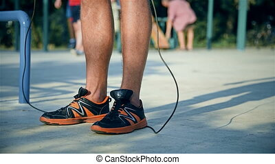 Man Jumps On A Skipping Rope. Crossfit Concept. Close Up
