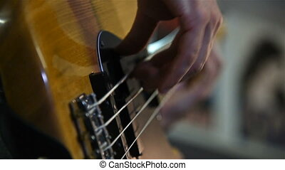 Man Playing On Bass Guitar. Slow Motion Effect