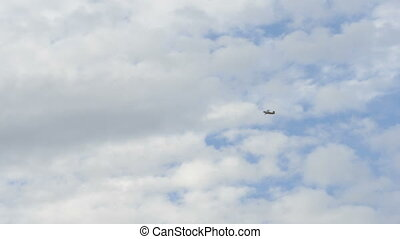 Small aiplane flies in the sky.