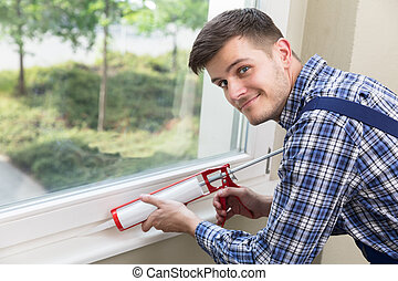 Worker Applying Silicone Sealant With Silicone Gun