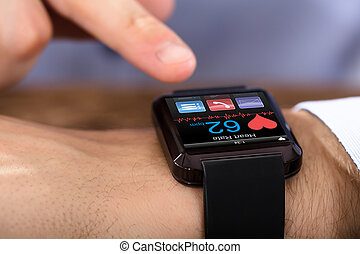 Person Hand Wearing Smart Watch Showing Heartbeat Rate