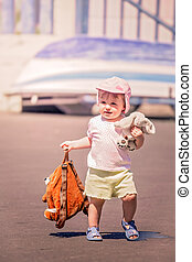 Little cute girl carrying her doggy backpack - Little cute...