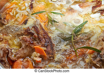 Delicious savory meat stewed with vegetables and rosemary...
