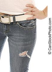 woman wearing jeans - torso of slim woman wearing denim...