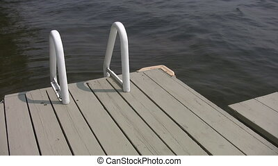 Summer dock - Ladder on dock Summertime at the lake Ontario,...