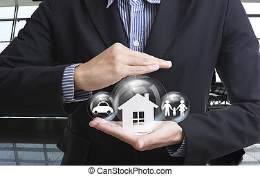 business salesman hand holding home, car, family concept...