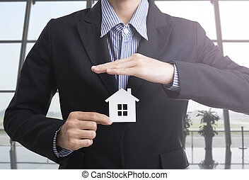 business salesman hand holding home concept home insurance.
