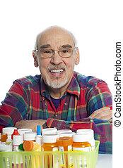 senior with prescription bottles