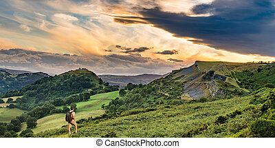 Hiker and sunset over Llangollen panorama - Senior male...