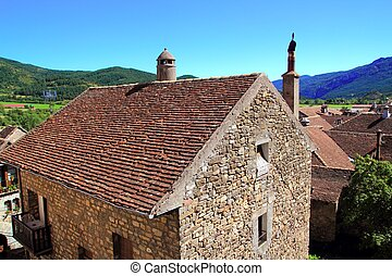 Hecho Valley Pyrenees village roof and mountains Aragon...