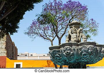 Fountain in Square in Puebla - Fountain in a plaza in the...