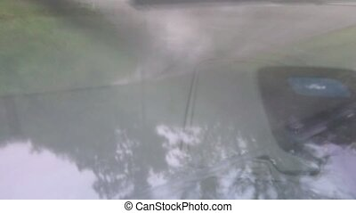 Driving shot with mounted camera. Point of view - driving during rainy weather. Windshield wipers move during rain