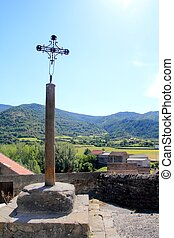 Way of Saint James cross stone pilgrims statue in Pyrenees...