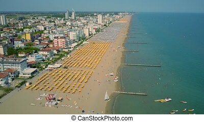 Aerial view of a big sandy beach in Italy. Summer vacation time