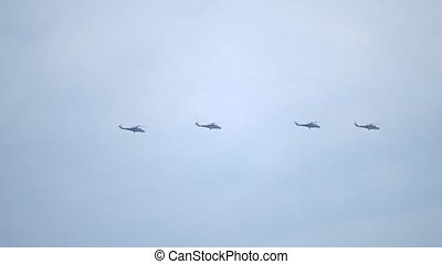 Four Russian Air Force attack helicopters flying in the sky