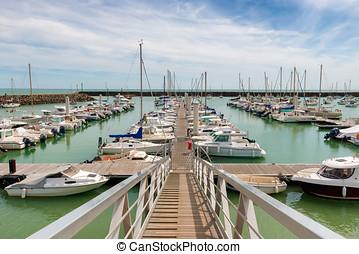 yachts docked in a marina