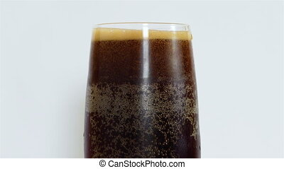 Glass of Beer - Glass of dark Beer on white background. 4k...