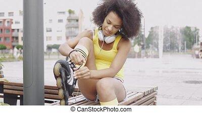 Sportive woman wearing rollers - Pretty ethnic girl in...